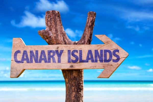 Canary Islands wooden sign with beach background